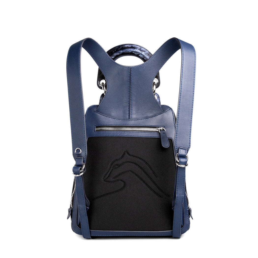 Cushioned back of women's designer mini backpack in dark blue leather.