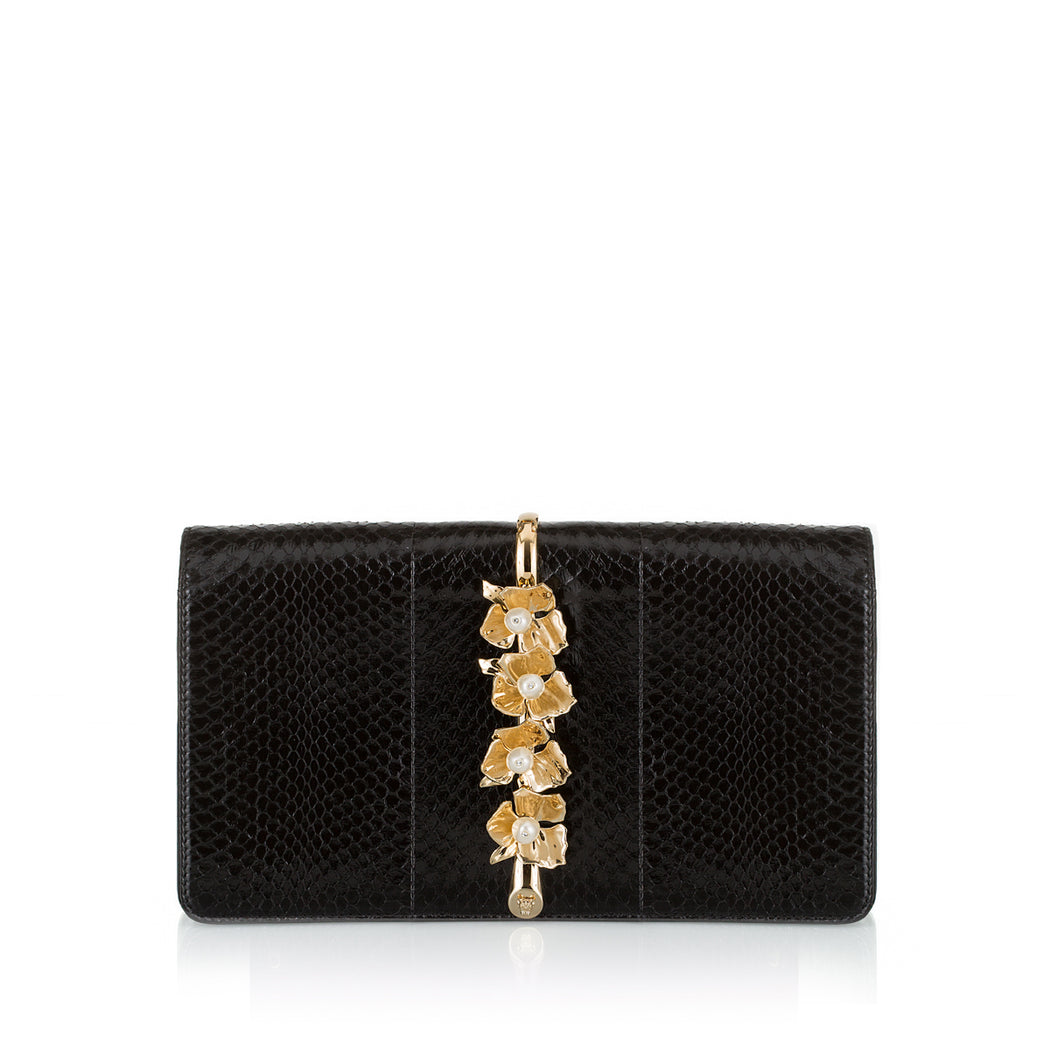 This fold-over style clutch bag in Black Watersnake is a smaller size, sitting upon a beautiful brass vine and embellished with elegant pearl stones. This roomy clutch is comfortable to hold and easily fits everything you need. Magnetic top closure. Handmade in Italy.