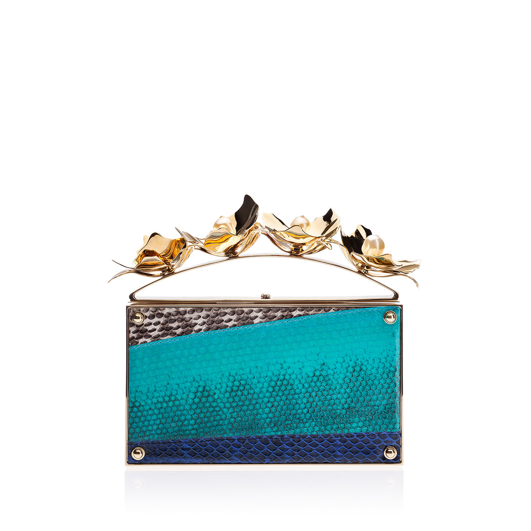 Designer clutch in blue snakeskin with brass & pearl ornament