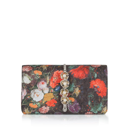 This fold-over style clutch bag in Bouquet Silk Jacquard is a smaller size, sitting upon a beautiful brass vine and embellished with elegant pearl stones. This roomy clutch is comfortable to hold and easily fits everything you need. Magnetic top closure. Handmade in Italy.