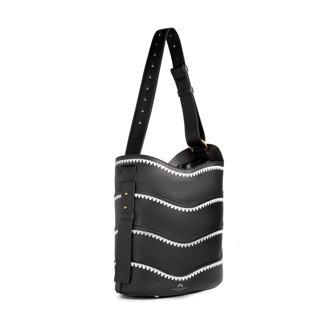 Women's designer handbag: Bucket purse in black leather and white crowfeet stitching