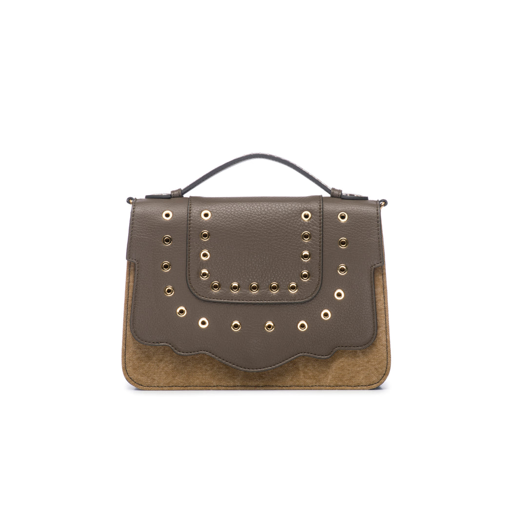 This best-selling top handle luxury leather bag in military green calfskin and canvas features a detachable crossbody leather and fabric strap. The front flap is adorned with gold-toned eyelets for a decorative touch. Make it your own with a fur Duma Hok-Pom or our signature leather tassel or opt for one of our leather guitar straps for an on-trend look. It is one of the easiest to accessorize handbags.