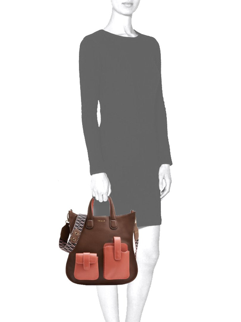Mannequin carrying a luxury tote bag