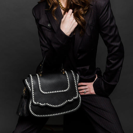 Women's designer satchel in black leather with white trim