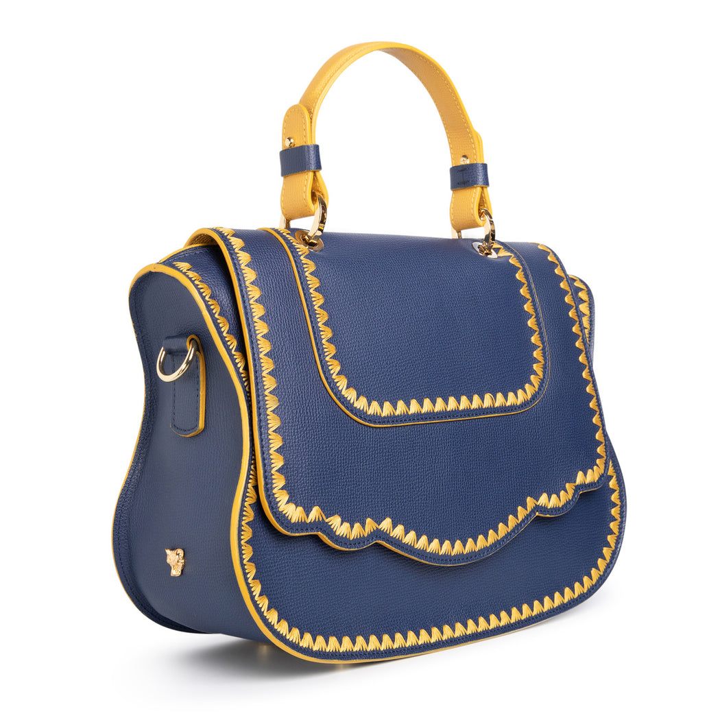 Women's designer handbag in blue leather with yellow stitching.