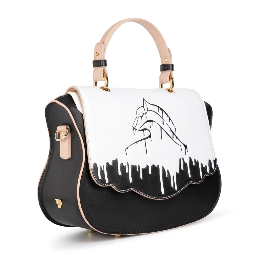 Designer satchel for women with puma logo and black and white drip design.