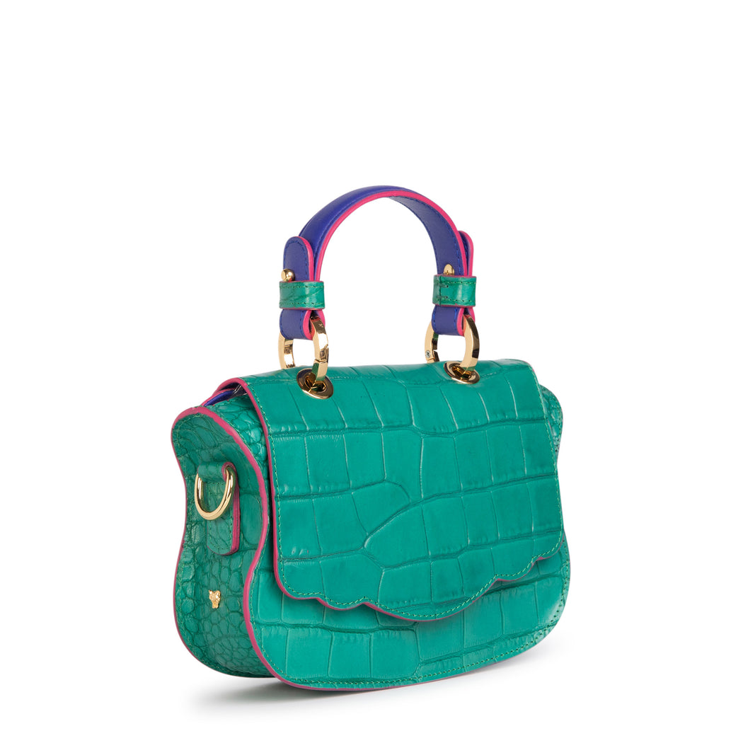 Green croc-embossed handbag that can be worn as a mini crossbody bag