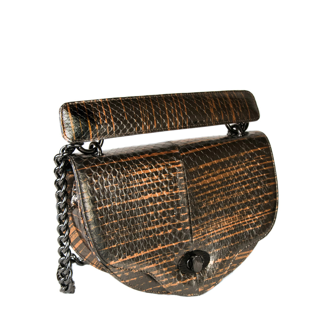 Luxury crossbody handbag in brown snakeskin with chain strap, crescent-shaped