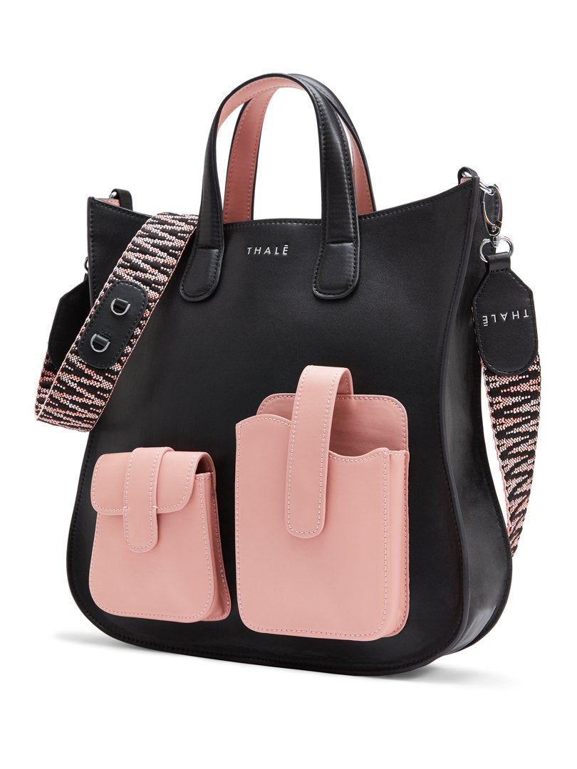 Black designer tote bag with pink pockets