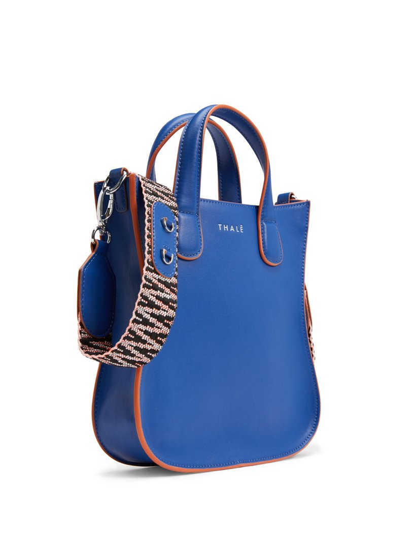 Monogrammed small designer leather tote bag in blue leather