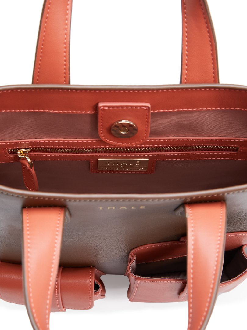 Inside a luxury tote bag in brown leather & salmon-pink inner lining