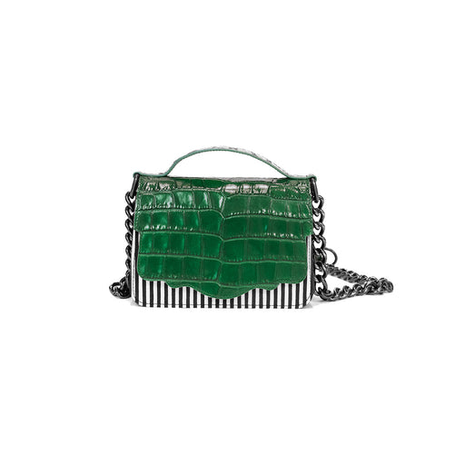 The double-sided Audreyette Mini in black and white striped canvas with emerald green embossed croc and black and white elaphe is a luxury handbag for every day. It's the same petite bag as the original Audreyette Mini, but with double the space. A designer crossbody bag that fits all the essentials. Can be worn as a crossbody or the strap can be doubled and worn on the shoulder. Elaphe top handle adds an extra dimension of texture.