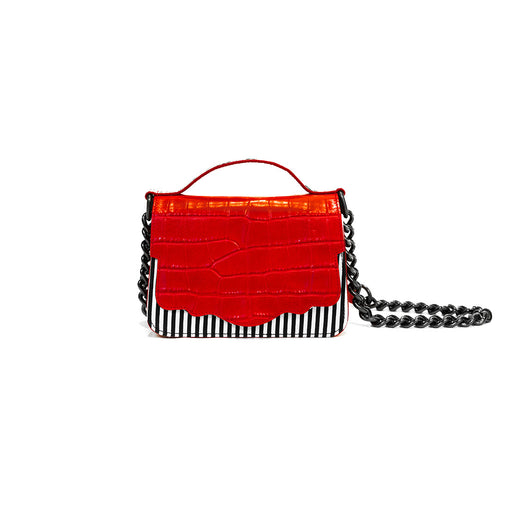 The double-sided Audreyette Mini in black and white striped canvas with tomato red embossed croc and black and white elaphe is a luxury handbag for every day. It's the same petite bag as the original Audreyette Mini, but with double the space. A designer crossbody bag that fits all the essentials. Can be worn as a crossbody or the strap can be doubled and worn on the shoulder. Elaphe top handle adds an extra dimension of texture.