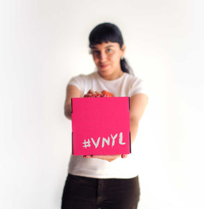 Girl holding VNYL gift membership box