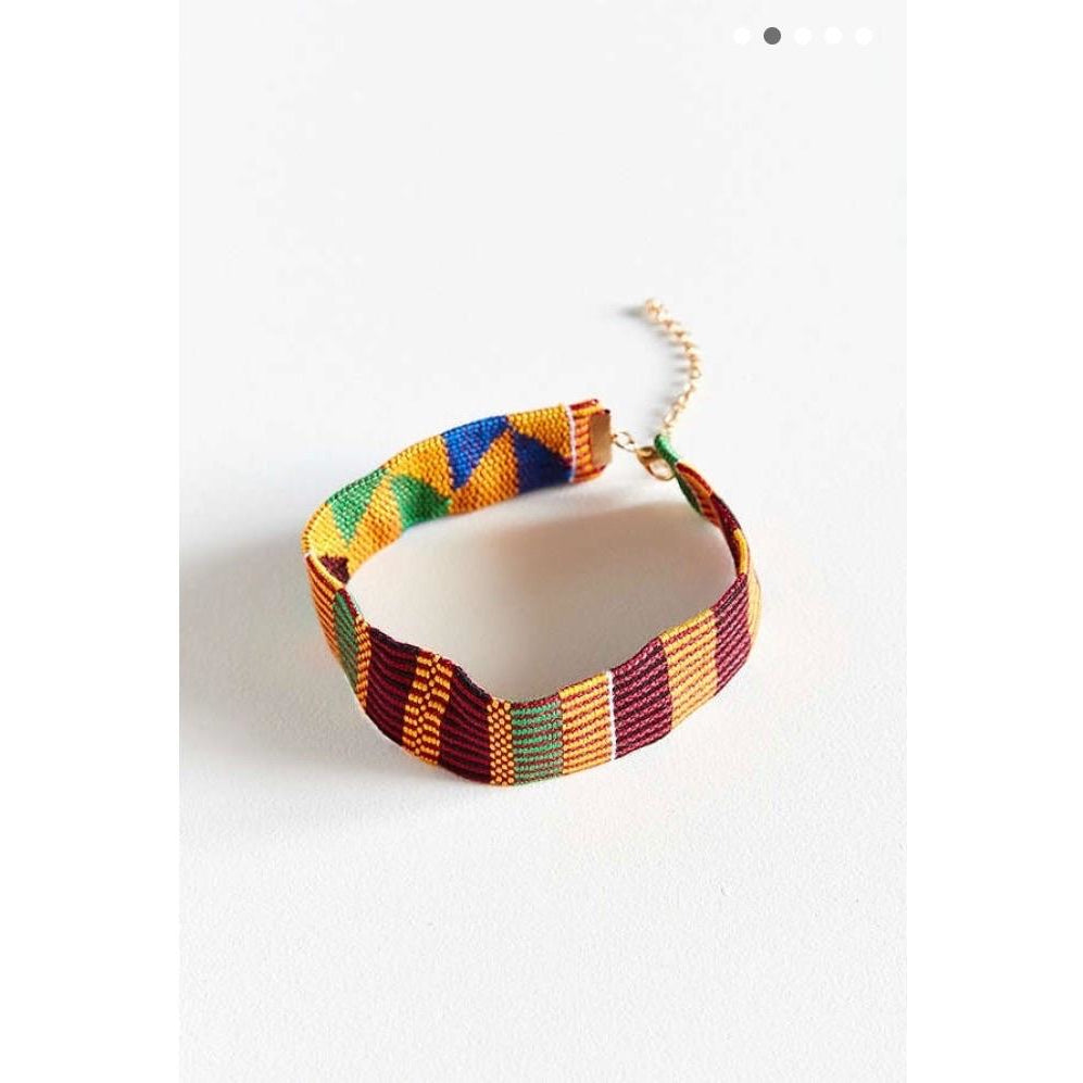 The Kente Cloth used in this design is called Boatemaa. This Boatemaa Choker is also available in Urban Outfitters (Online Only).