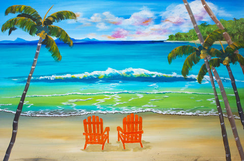 Deck chairs on a tropical beach under the palm trees