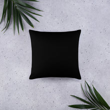 Purple abstract pattern on square pillow black back