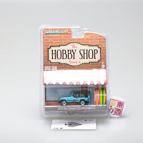 GreenLight 1:64 The Hobby Shop Series 2 - 1987 Jeep Wrangler YJ with Surfboard 97020-C