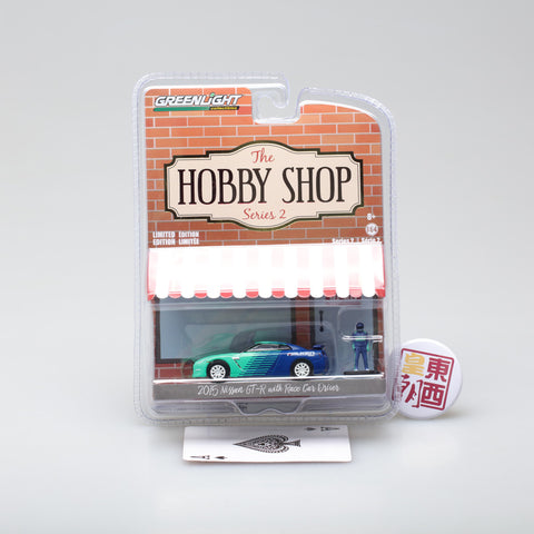GreenLight 1:64 The Hobby Shop Series 2 - 2015 Nissan GT-R (R35) Falken Tires with Race Car Driver 97020-D