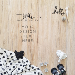 Monochrome baby themed flatlay on wood