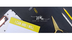Black leather desk banner with pops of yellow
