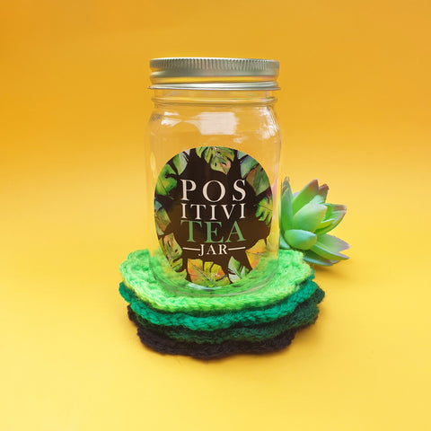 """PositiviTEA"" jar with crochet coasters - black/greens"