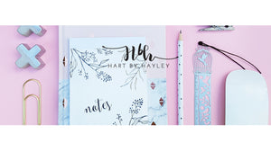 Pink desk banner with white & gold accessories.