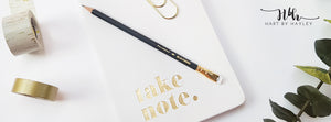 Stylish white desk banner with gold accessories.