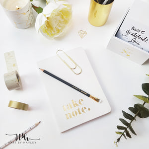 White desk set up with gold accessories stock photo