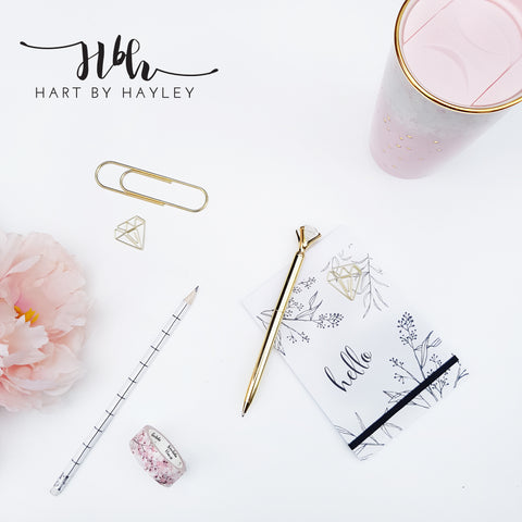 White desk with pink and gold accessories