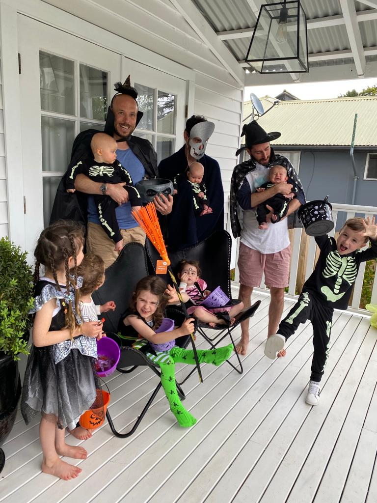Family celebrate Halloween at home dads and kids