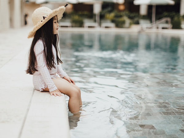 Little girl wearing Willow Swim Sophia swimsuit at Calile Hotel