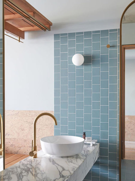 The pastel hues bathrooms Calile Hotel