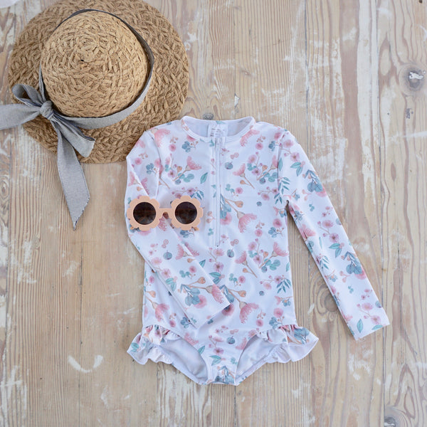 Willow Swim Sophia girls swimsuit in Gumnuts lifestyle shot with hat and sunnies