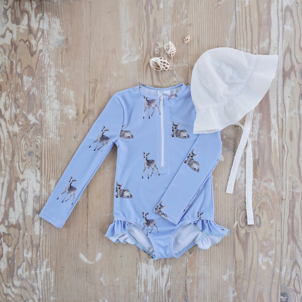 Willow Swim Sophia girls swimsuit in Dreamy Fawn lifestyle shot with hat