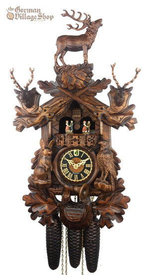 German Cuckoo Clock 8 day mechanical hunters scene with stag and stag heads