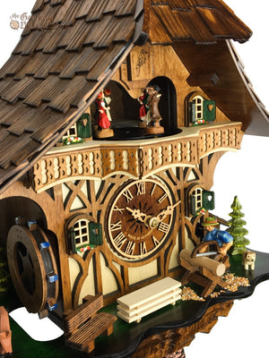 German Cuckoo Clock 8 day mechanical black forest chalet with music and moving wood sawyer man