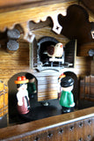 German Cuckoo Clock battery operated black forest chalet with beer drinkers and music cuckoo bird