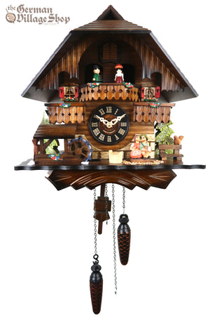 German Cuckoo Clock battery operated black forest chalet with music and moving kissing couple