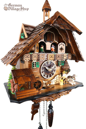 German Cuckoo Clock battery operated black forest chalet with moving wood chopper and music
