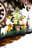German Cuckoo Clock battery operated black forest chalet with moving beer drinkers and music - close up of beer drinkers
