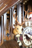 German Cuckoo Clock battery operated black forest chalet with moving beer drinkers and music - close up of stag head