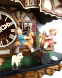 German Cuckoo Clock battery operated black forest chalet with see saw and music - close up of see saw