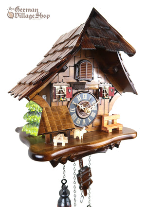 German Cuckoo Clock battery operated black forest chalet with red window shutters