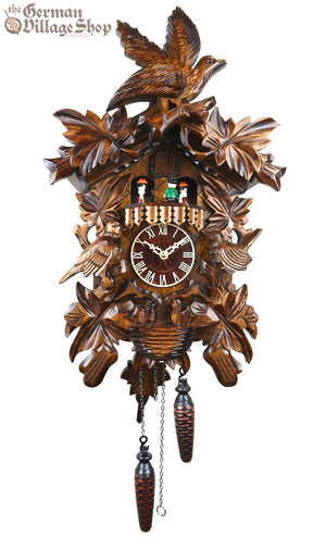 German Cuckoo Clock battery operated with cuckoo bird carvings and music