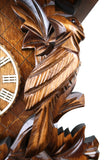 German Cuckoo Clock 8 day mechanical traditional cuckoo bird carvings - close up of carvings