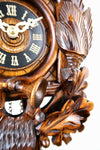 German Cuckoo Clock battery operated After the hunt scene - close up of clock face