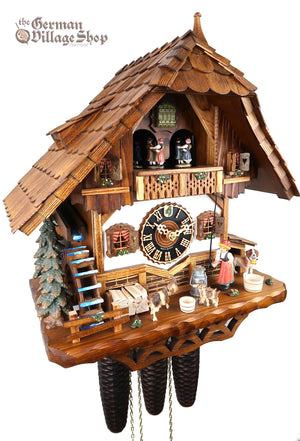 German Cuckoo Clock 8 day mechanical black forest chalet with moving bell wringer and music