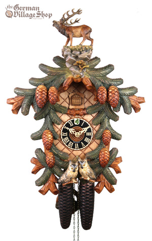 German Cuckoo Clock 8 day mechanical with stag and owl carvings with pine tree and pine cones