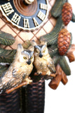 German Cuckoo Clock 8 day mechanical with stag and owl carvings with pine tree and pine cones - close up of owls